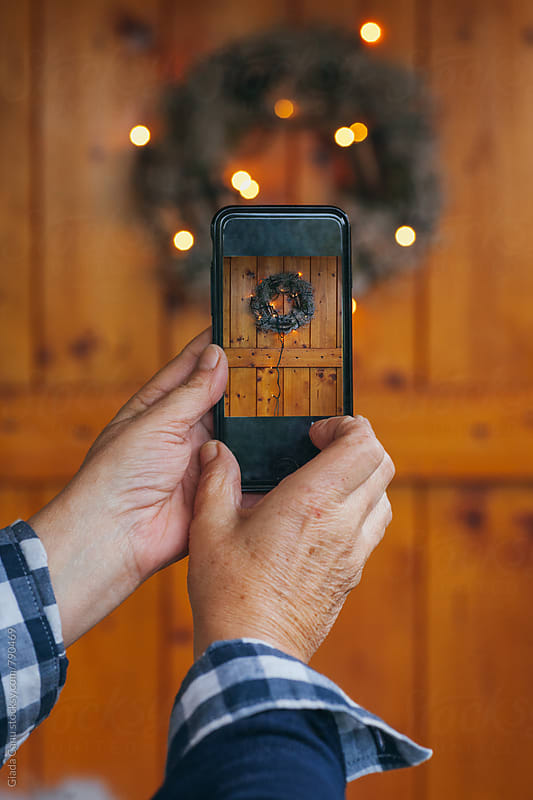 Taking a picture of a christmas decoration by Giada Canu for Stocksy United