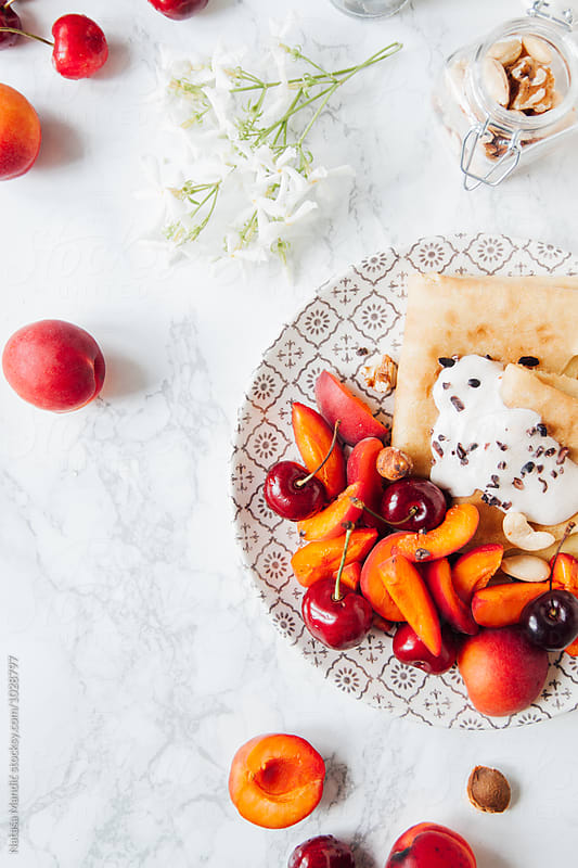 Crepes with fresh fruit by Nataša Mandić for Stocksy United