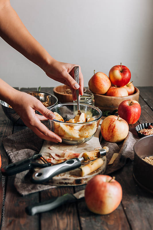 Preparing apples for the crumble pie by Nataša Mandić for Stocksy United