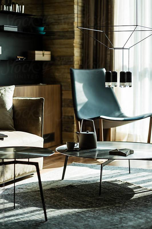 Beautifully lit table in living room of contemporary interior by Aleksandar Novoselski for Stocksy United