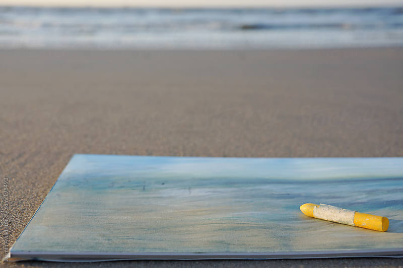 Freshly made oil crayon painting at the beach  by Jasmin Awad for Stocksy United
