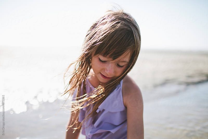 little girl on beach by Erin Drago for Stocksy United
