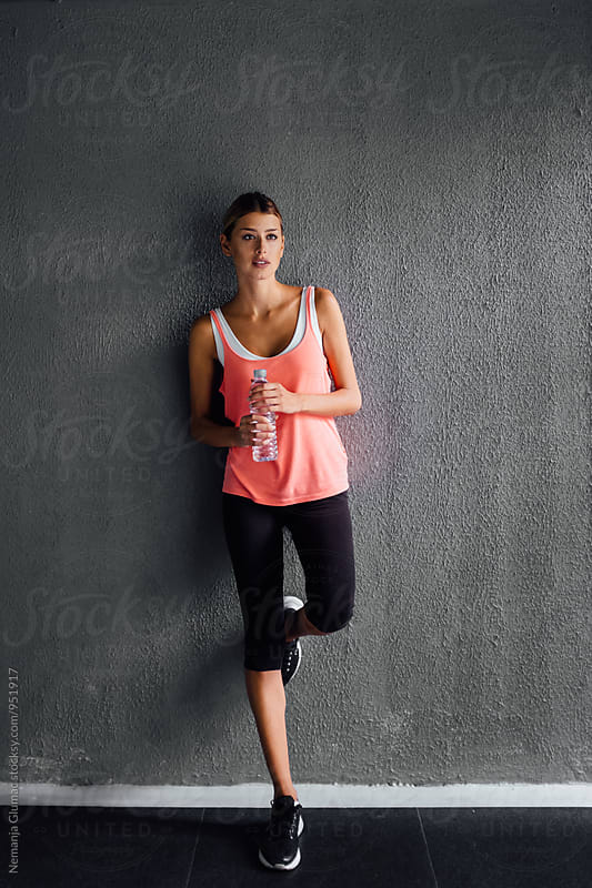 Athlete Woman Resting During a Workout by Nemanja Glumac for Stocksy United