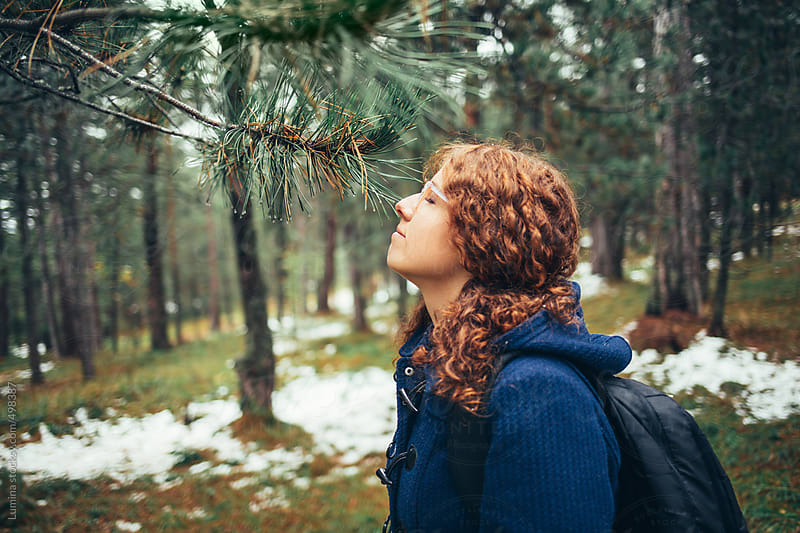 Woman Smelling a Pine Tree by Lumina for Stocksy United