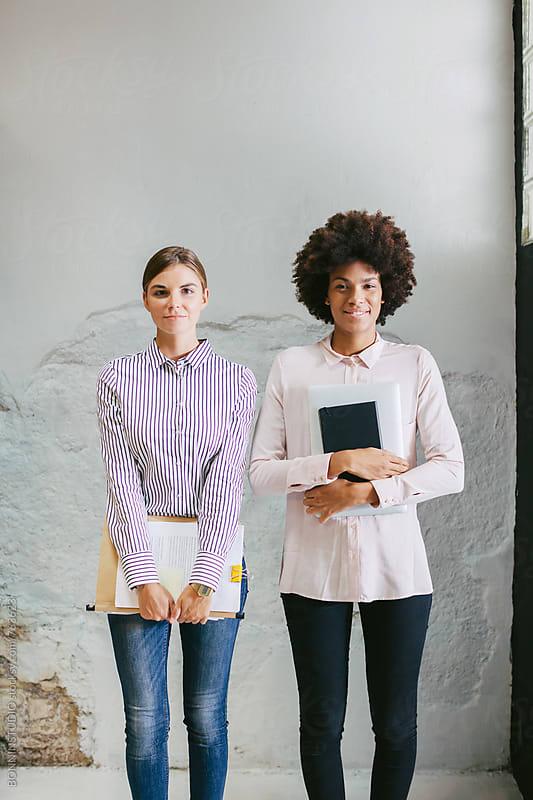 Portrait of businesswomen team at office. by BONNINSTUDIO for Stocksy United