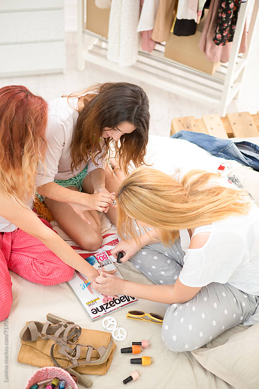 Teenage Girls Painting Nails by Lumina for Stocksy United