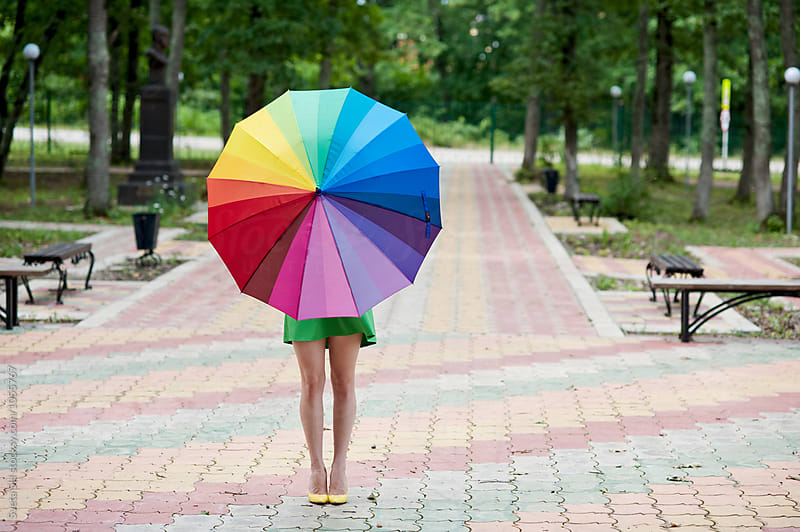 Rainbow umbrella by Svetlana Shchemeleva for Stocksy United