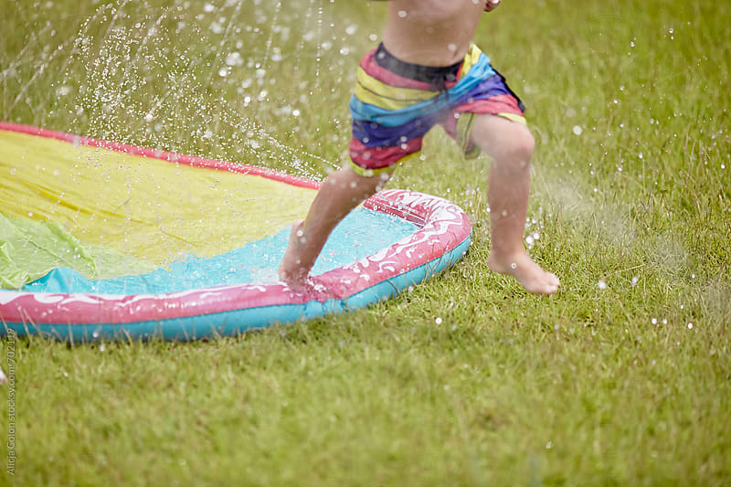 Wet Summer Fun by Alicja Colon for Stocksy United