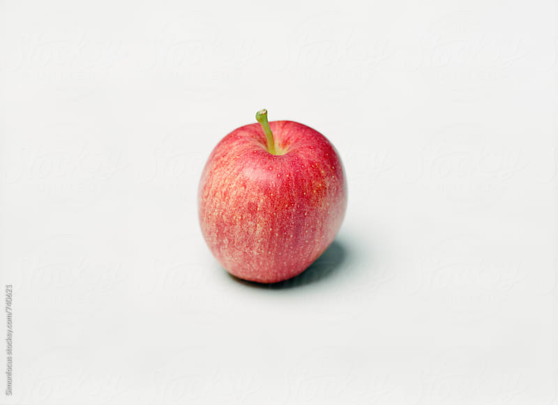 Organic red apple by Simon DesRochers for Stocksy United