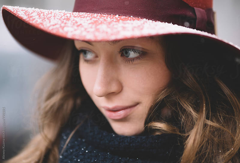 winter portrait of young woman with hat on the street by Vesna for Stocksy United