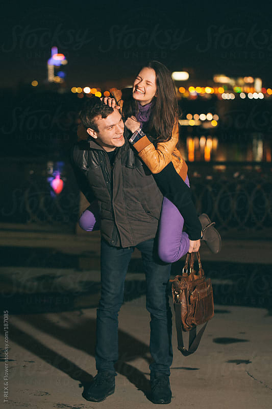 Man holding his girlfriend by Danil Nevsky for Stocksy United