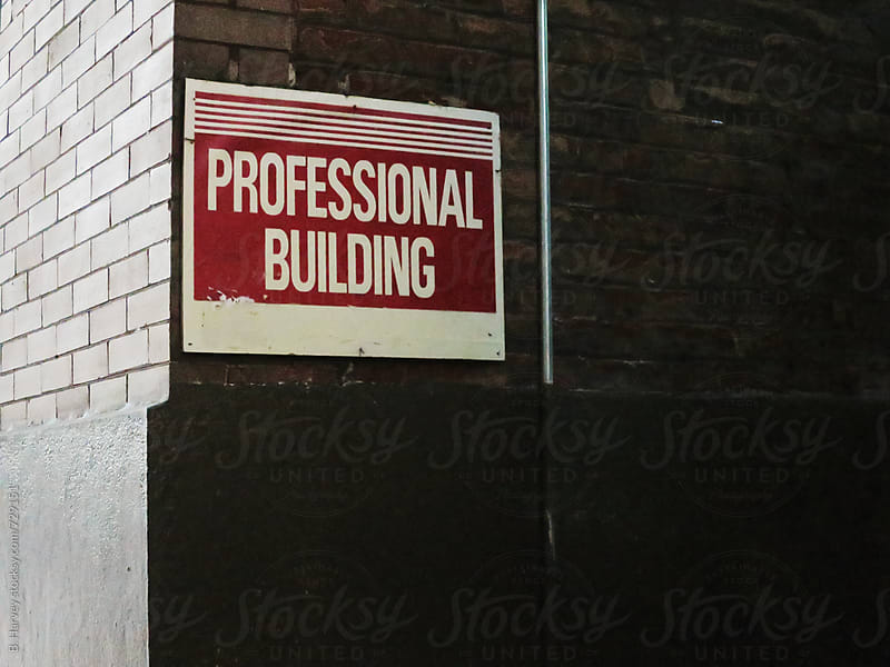 Professional Building sign on building by B. Harvey for Stocksy United