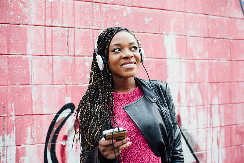 Young african woman enjoying music by michela ravasio for Stocksy United
