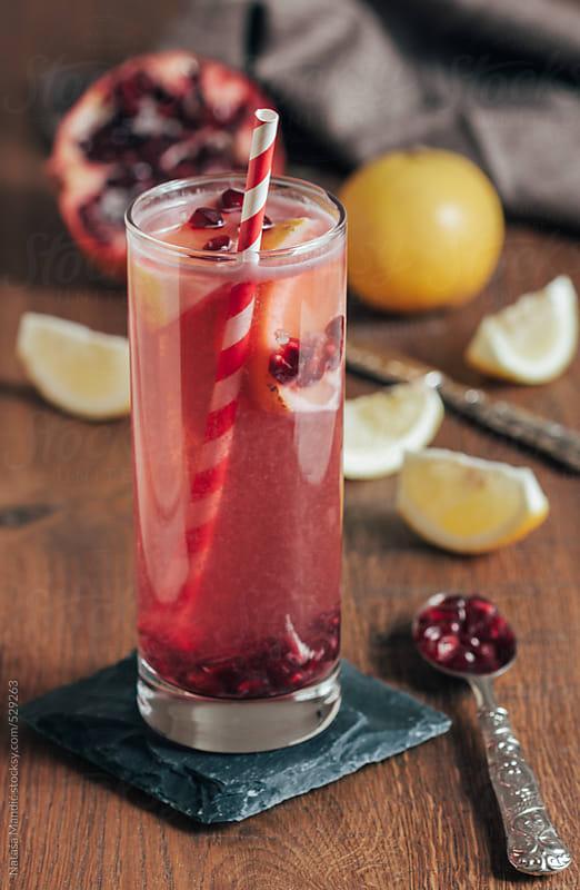 Fresh cocktail with pomegranate and lemon by Nataša Mandić for Stocksy United
