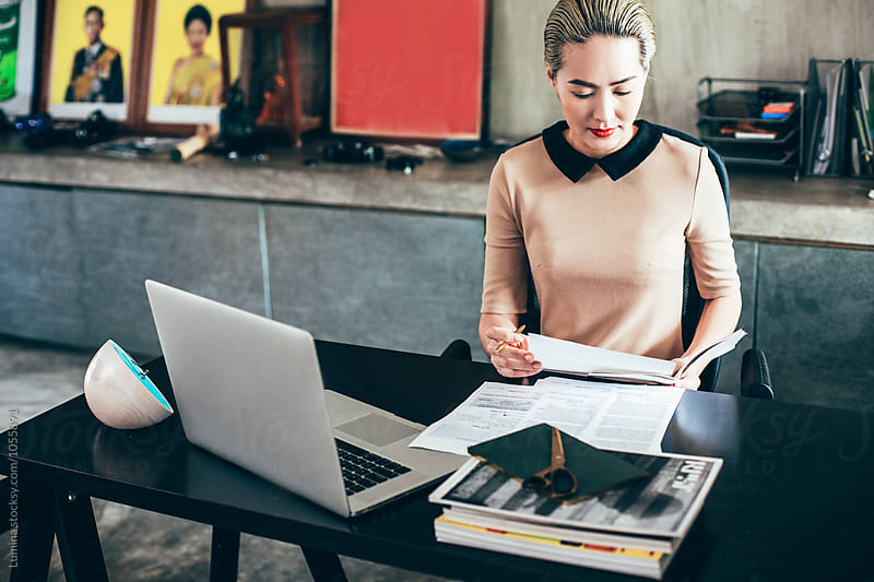 Businesswoman Working at Her Office by Lumina for Stocksy United