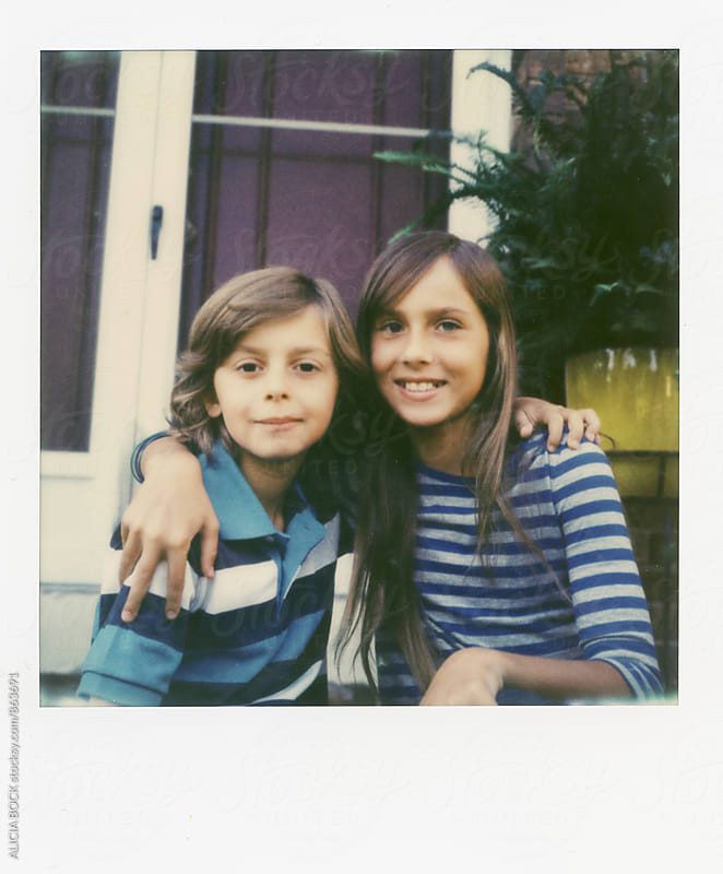 Polaroid Portrait Of Siblings Sitting Together Wearing Striped Shirts by ALICIA BOCK for Stocksy United