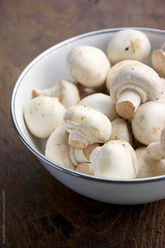 Button mushrooms by Harald Walker for Stocksy United