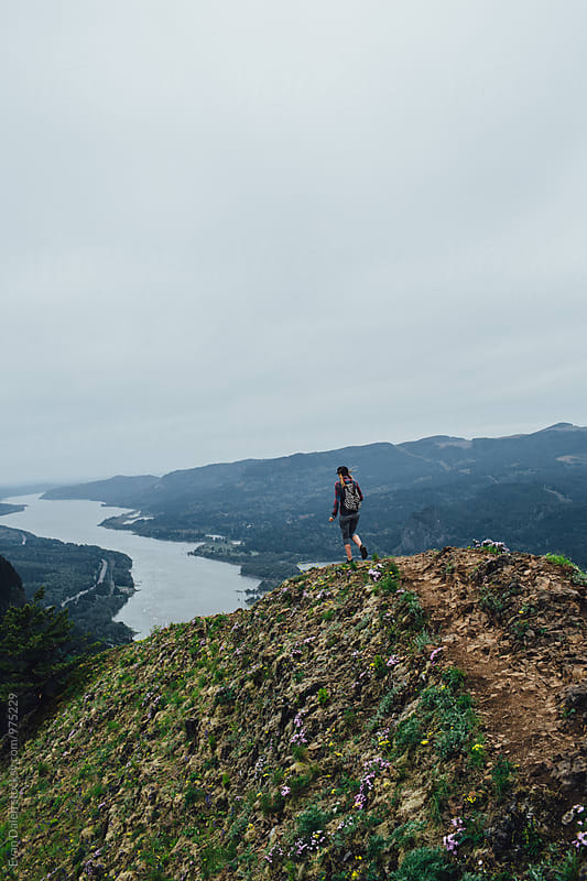 Woman Hiker Walking Down Mountain Ridge by Evan Dalen for Stocksy United