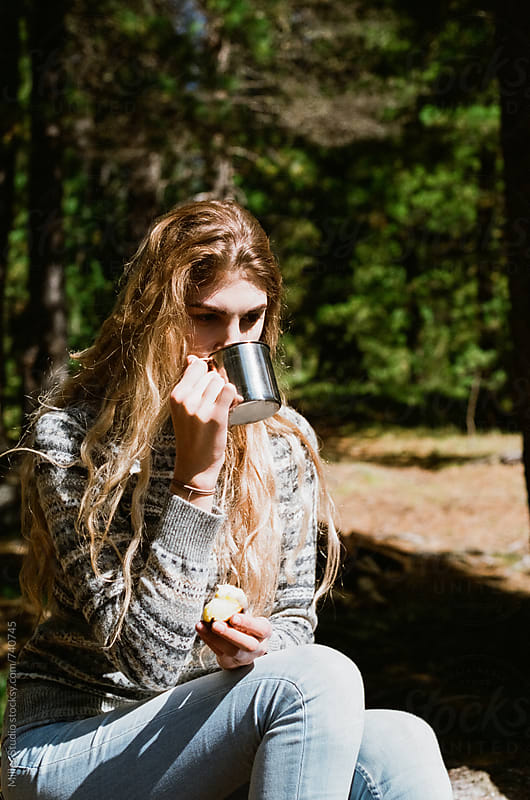 Young woman drinking tea by Milles Studio for Stocksy United