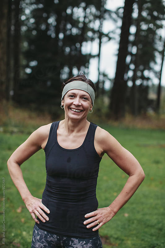 Post workout portrait of sweaty middle age caucasian woman - smiling outside by Rob and Julia Campbell for Stocksy United