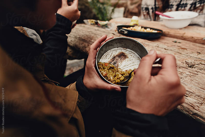 Quinoa for Dinner while camping in Canada by Taylor Roades for Stocksy United