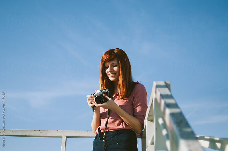 Portrait of a Ginger Girl With Retro Camera by Brkati Krokodil for Stocksy United