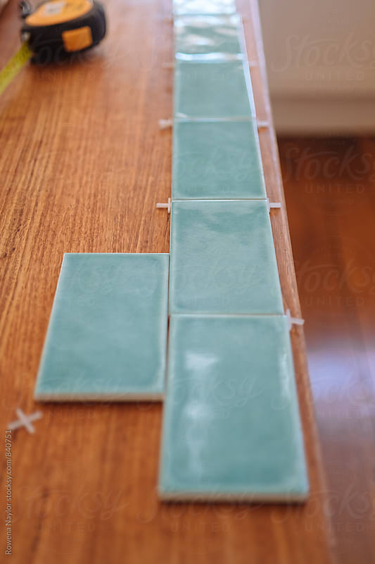 Kitchen tiles being prepared by Rowena Naylor for Stocksy United