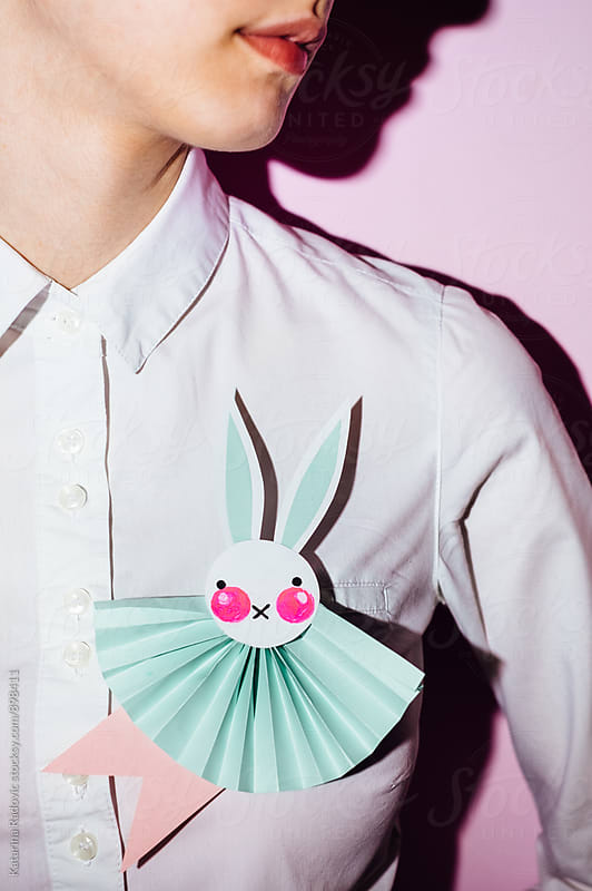 Woman Wearing Easter Bunny Rosette  by Katarina Radovic for Stocksy United