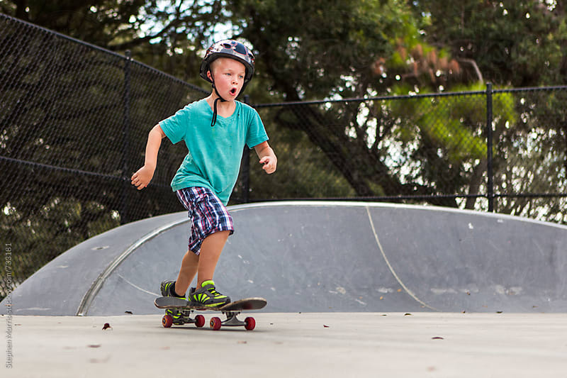 Boy Riding a Skateboard by Stephen Morris for Stocksy United