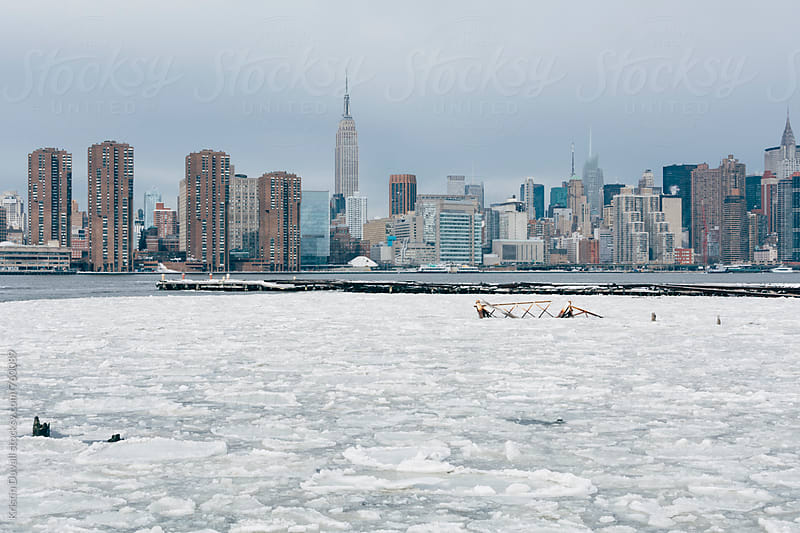 Ice floes in East River. New York City. by Kristin Duvall for Stocksy United