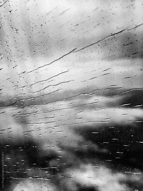 View of rainy airplane window during flight by Juri Pozzi for Stocksy United