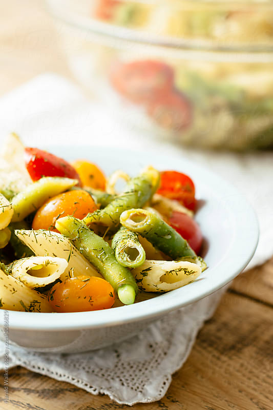 Penne Pasta Salad with Green Beans and Tomatoes by Harald Walker for Stocksy United
