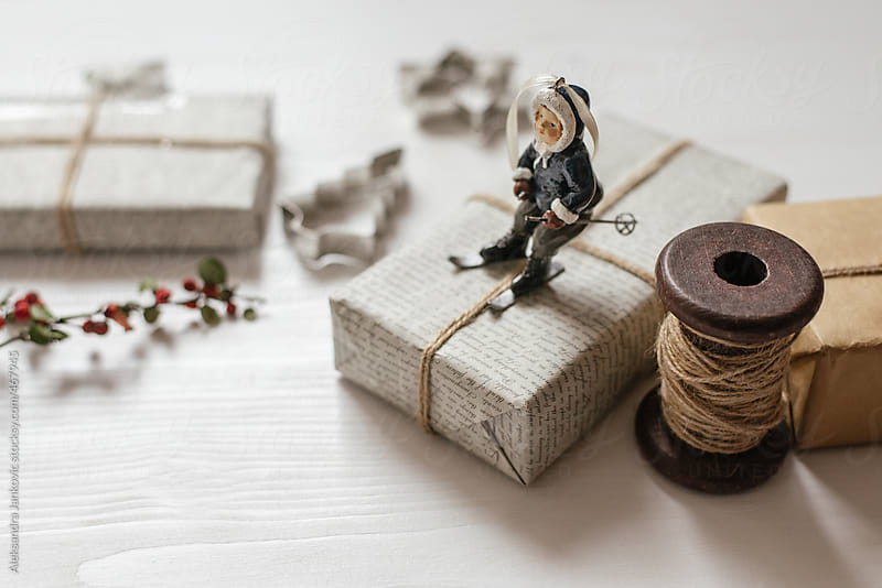Christmas ornament and presents on the white table by Aleksandra Jankovic for Stocksy United