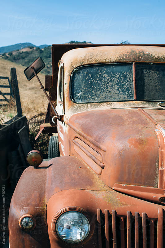 Old rusty, vintage truck in the country by Carolyn Lagattuta for Stocksy United