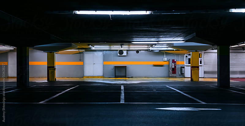 Parking /car garage during late night hours. by Marko Milanovic for Stocksy United