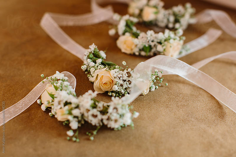 Close up of floral wedding accessory by Amir Kaljikovic for Stocksy United