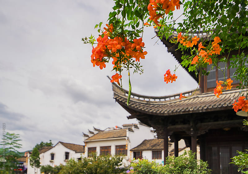 Ancient Chinese architecture with flowers,Zhejiang Province,China by Miss Rein for Stocksy United