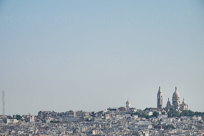 A view across Paris, with the Sacre Coeur on the horizon by Jon Attaway for Stocksy United
