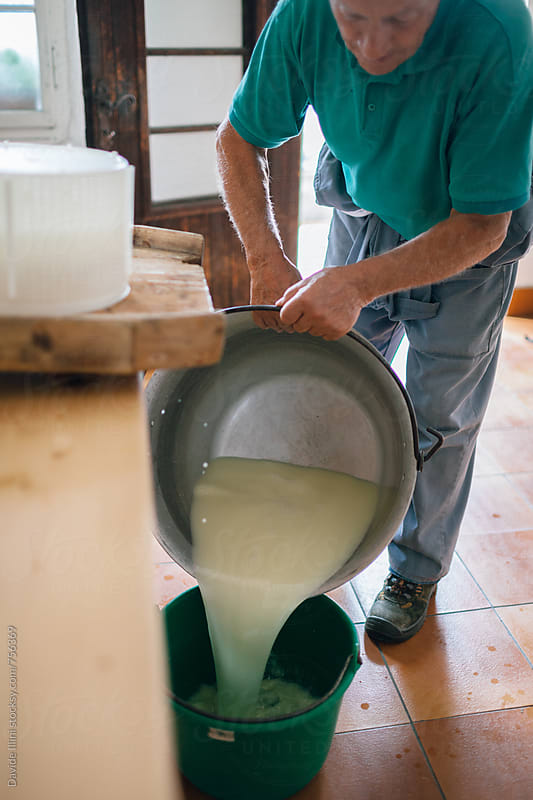 Senior man making homemade cheese by Davide Illini for Stocksy United