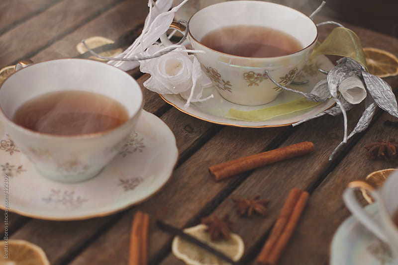 Hot tea in a decorative porcelain set with Winter spices by Beatrix Boros for Stocksy United