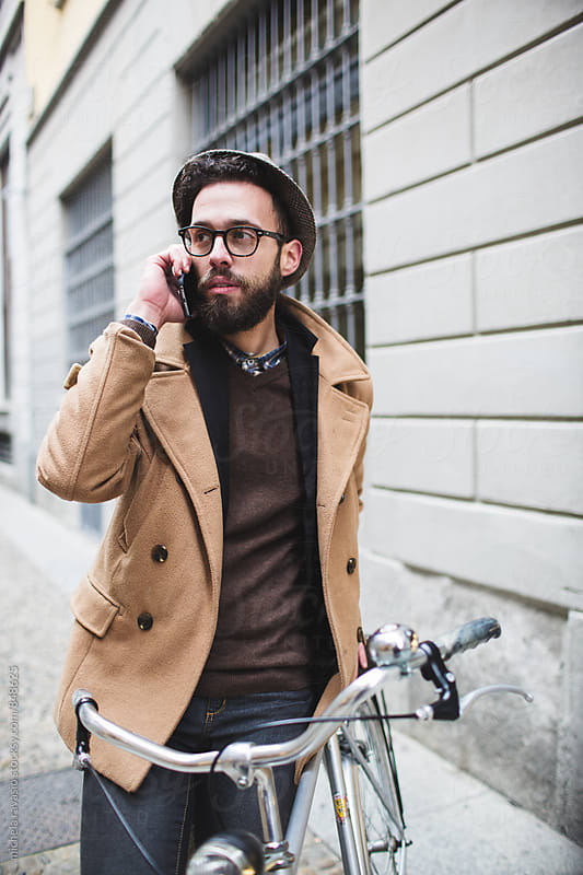 Young hipster talking on cell phone by michela ravasio for Stocksy United