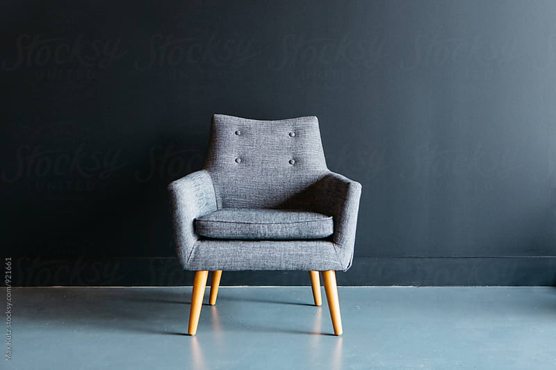 Tufted Chair on Black. by Max Kütz for Stocksy United