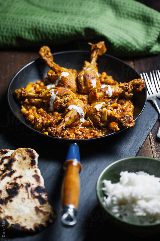 Homemade chicken curry. by Darren Muir for Stocksy United