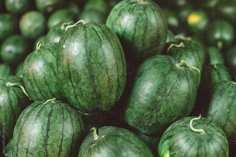 Whole Watermelons on a heap by Aleksandra Kovac for Stocksy United