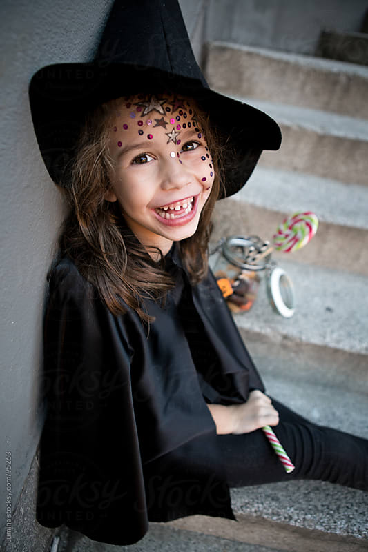 Girl in a Witch Costume With Halloween Treats by Lumina for Stocksy United