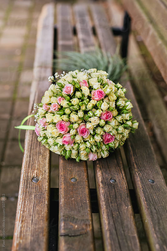 Pastel roses wedding bouquet on a bench by Pixel Stories for Stocksy United