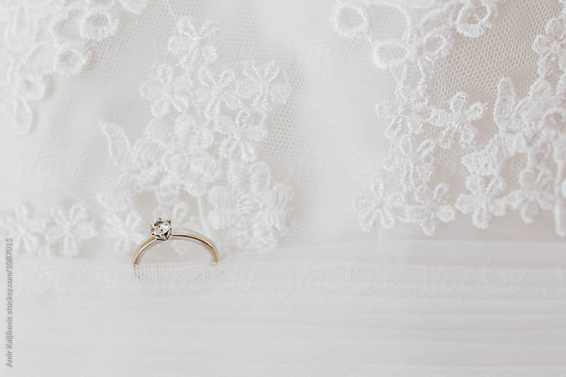 Wedding or engagement ring on a lacy veil by Amir Kaljikovic for Stocksy United
