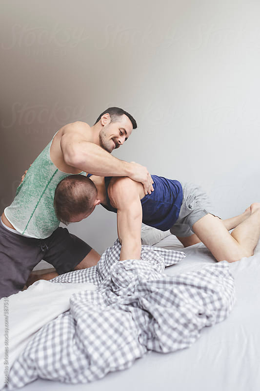 Gay Jock Lovers Playfully Horsing Around Wrestling in Bed by Joselito Briones for Stocksy United