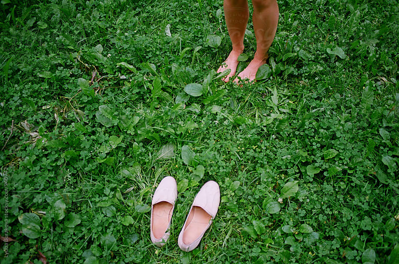 Shoes, grass, barefoot,summer by Liubov Burakova for Stocksy United