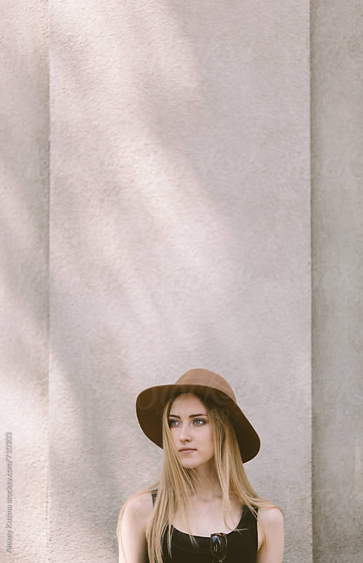 real young woman with hat  by Alexey Kuzma for Stocksy United